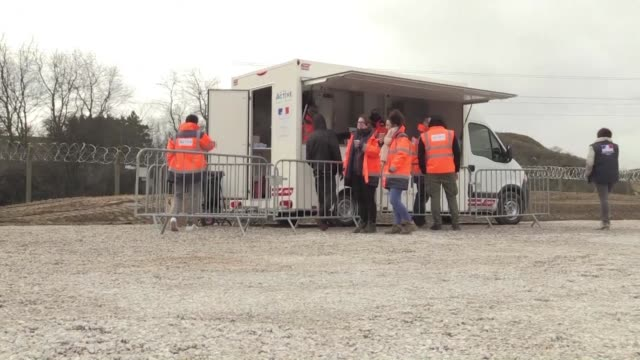 The distribution of the first state funded meals to Calais migrants was carried on Tuesday by NGOs with few migrants visiting the aid trucks possibly...