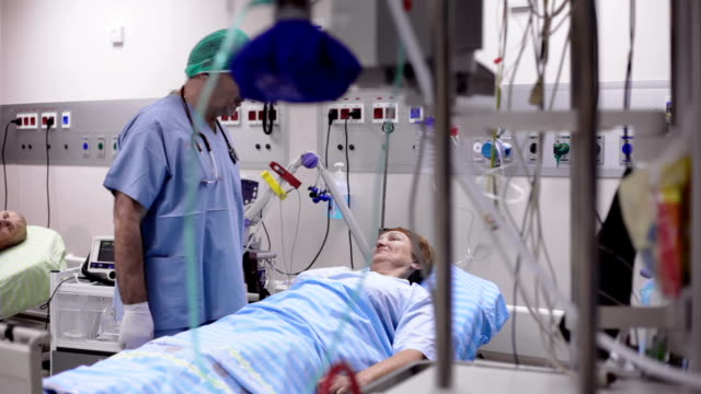 the doctor examines patient after operation - defibrillator stock videos & royalty-free footage