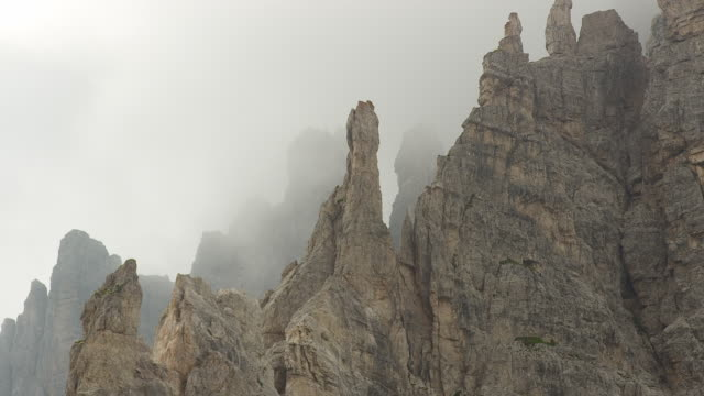 the dolomite mountains shrouded in fog, drei zinnen - tre cimo di lavaredo stock videos & royalty-free footage