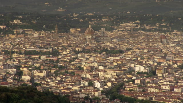 the dome of florence cathedral dominates the florence skyline. available in hd. - florence stock videos and b-roll footage