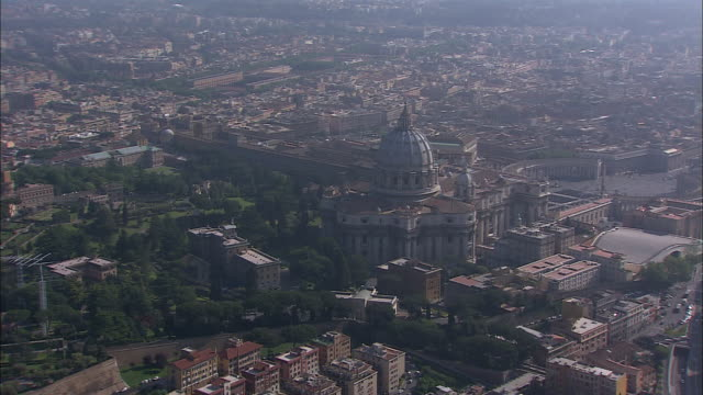 the dome of saint peter's basilica towers over rome, italy. - state of the vatican city stock videos & royalty-free footage
