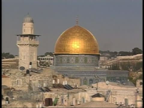 the dome on the dome of the rock shines in the sunlight near the wailing wall. - old town stock videos & royalty-free footage