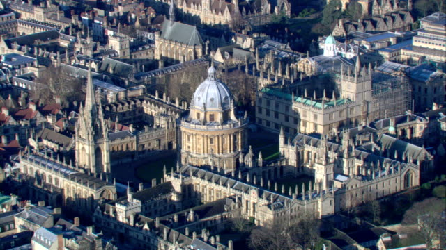 the domed building of the bodleian library stands in the centre of the oxford university campus. - oxford university stock videos & royalty-free footage