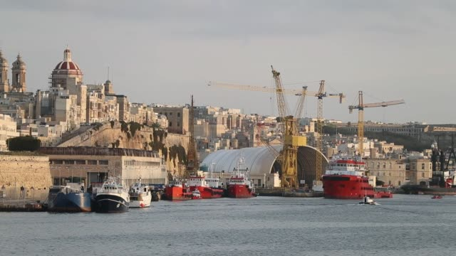 The domed roof of St Philip's Church stands above waterfront hotels and residential property in Senglea Malta on Wednesday Feb 1 Cranes stand in the...