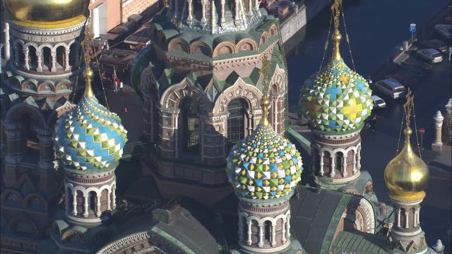 The domes of St. Petersburg's  Church of the Savior on Spilled Blood feature elaborate decoration.