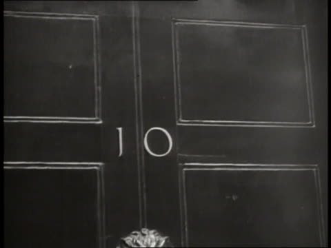 the door of london's 10 downing street displays the address. - 10 downing street stock videos & royalty-free footage