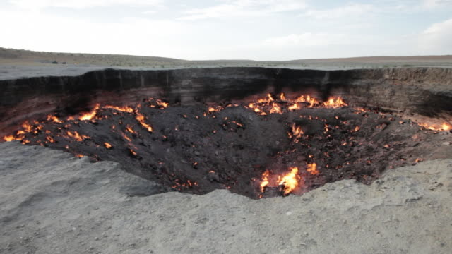 """The """"Door to Hell"""" or Darvaza Crater in Turkmenistan at dusk"""