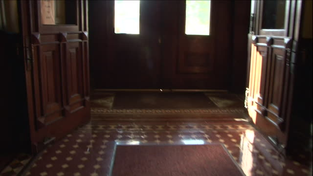 the doors of a courthouse open to a sunny street. - lobby stock videos & royalty-free footage