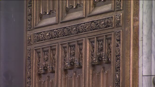 the double doors underwent a threemonth conservation and restoration that cost $500000 each door weighs 9200 pounds and is decorated with sculptures... - st. patrick's cathedral manhattan stock videos and b-roll footage