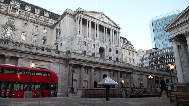 the double-decker bus passes by the bank of england in london, u.k., on thursday, dec. 17, 2020. bank of england policy makers make their final... - public transport stock videos & royalty-free footage