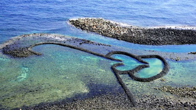 the double-heart stone trap in the penghu island of taiwan - tide stock videos & royalty-free footage