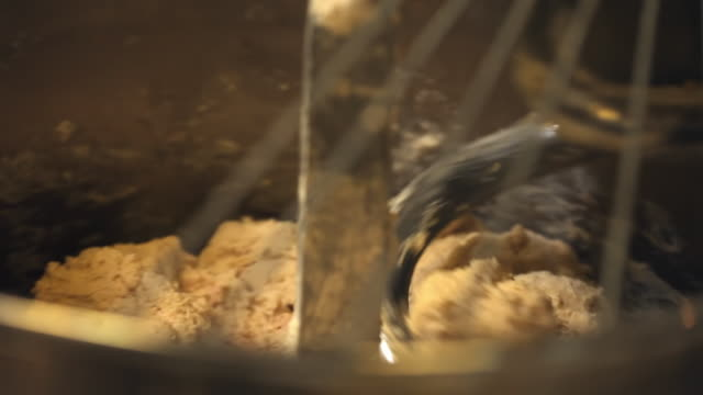 the dough is mixed with an electric mixer - dough stock videos & royalty-free footage