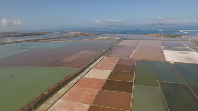 the dramatic landscape of the salt pans of trapani in sicily, italy - salt mineral stock videos & royalty-free footage