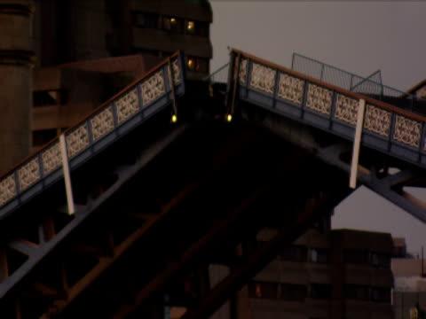 the drawbridge of the tower bridge raises. - drawbridge stock videos & royalty-free footage