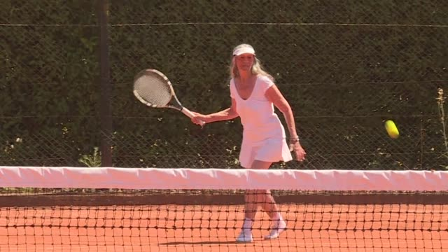 vídeos y material grabado en eventos de stock de the dream of becoming a tennis star has no age in argentina where an 83 year old grand mother who only resumed playing competitively at age 60 after... - sumar