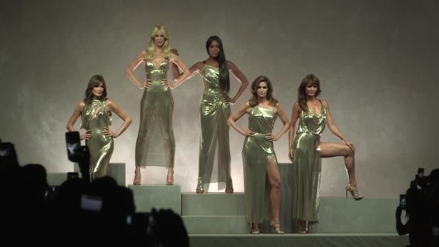 the dream team is back, carla bruni, claudia schiffer, naomi campbell, cindy crawford and helena christensen walk the runway for designer donatella... - versace designer label stock videos & royalty-free footage