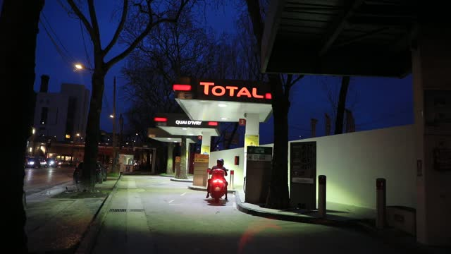 the driver of a scooter arrives at a total brand gas station to fill his tank on january 20, 2021 in paris, france. the multinational total announced... - automobile industry stock videos & royalty-free footage