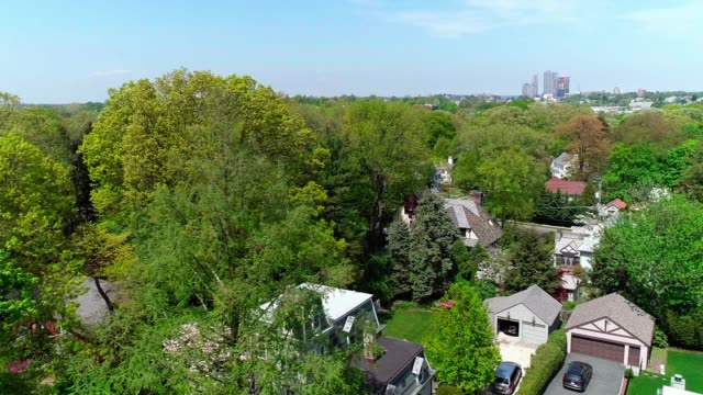 the drone aerial view of the residential district at the sunny spring day. pelham manor, westchester county, new york state. - eastern usa stock videos and b-roll footage