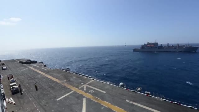 The dry cargo/ammunition ship USNS Richard E Byrd conducts a vertical replenishment with the multipurpose amphibious assault ship USS Bataan March 20...