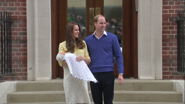 The Duchess of Cambridge delivers a baby girl Shows exterior shots Prince William the Duchess of Cambridge standing together holding the Princess in...