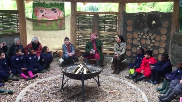 vídeos y material grabado en eventos de stock de the duchess of cambridge visits farms for city children in arlingham gloucester kate walks through the farm and then joins a storytime session led by... - michael morpurgo