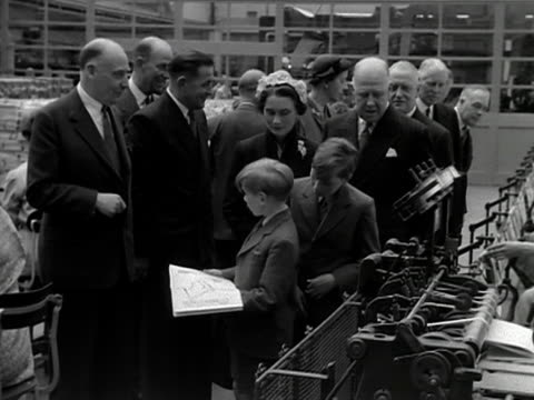 the duchess of gloucester and her two sons are shown around the printing works where the official souvenir coronation programme is being printed 1953 - coronation stock videos and b-roll footage