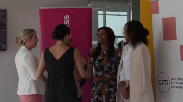 vídeos y material grabado en eventos de stock de the duchess of sussex chats enthusiastically with women as she arrives at the woodstock exchange in cape town to meet female entrepreneurs wearing a... - meghan duchess of sussex