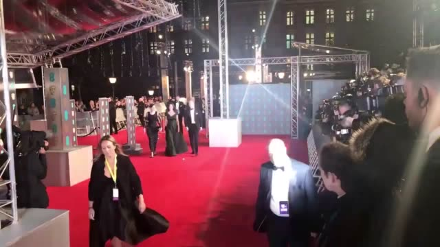 The Duke and Duchess of Cambridge walked the red carpet at the BAFTA awards Kate stepped out in a dark green Jenny Packham dress for the award...