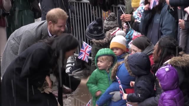 The Duke and Duchess of Sussex greet children during a visit the Old Vic on a snowy day in Bristol