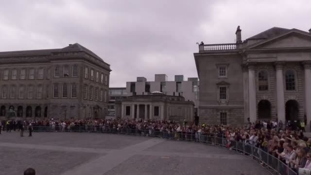 The Duke and Duchess of Sussex greet crowds in Trinity College Dublin after viewing the Book of Kells