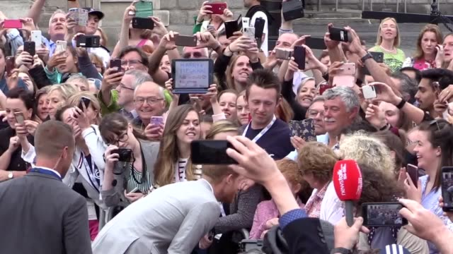 the duke and duchess of sussex greet members of the public outside trinity college in dublin on their royal tour - harry meghan tour stock videos and b-roll footage