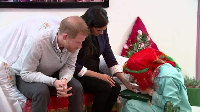 The Duke and Duchess of Sussex spend a day with schoolgirls in the Atlas Mountains MOROCCO Asni EXT Meghan Duchess of Sussex getting henna tattoo on...