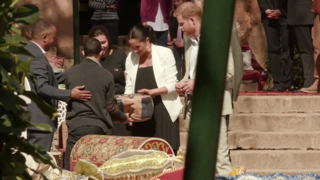 The Duke and Duchess of Sussex visit traditional craft market stalls at the Andalusian Gardens in Rabat Morocco during their threeday royal tour of...