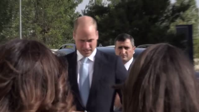 the duke of cambridge arrives at a crown prince foundation event in amman the capital of jordan and greets attendees before entering the building - herzog von cambridge stock-videos und b-roll-filmmaterial