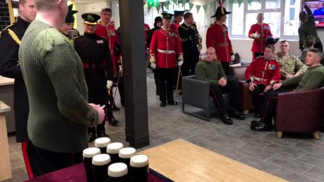 The Duke of Cambridge drinks a Guinness and the Duchess of Cambridge sips a water during a toast with the Irish Guards on St Patrick's Day in...