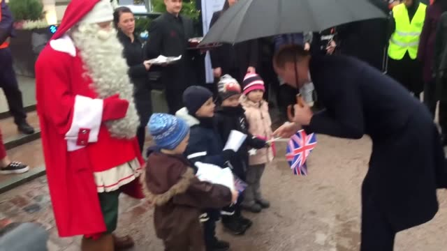 the duke of cambridge presents father christmas with prince george's festive wishlist a police car during his twoday trip to finland - herzog von cambridge stock-videos und b-roll-filmmaterial