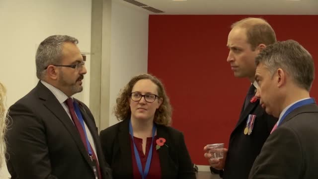 the duke of cambridge prince william meets with family liaison officers working with the grenfell tower families at hendon during a met passing out... - herzog von cambridge stock-videos und b-roll-filmmaterial