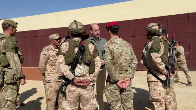 the duke of cambridge watched british troops and their kuwaiti counterparts storm a building during a dramatic military exercise as his tour of the... - middle east stock videos & royalty-free footage