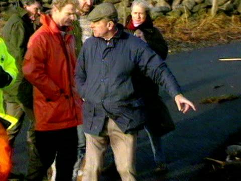 The Duke of Edinburgh inspects a beach near where the Braer oil tanker ran aground on the Shetland Islands
