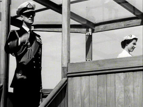 the duke of edinburgh salutes from an observation booth on hms surprise during the queen's inspection of the royal naval fleet at spithead. 1953. - peerage title stock videos & royalty-free footage