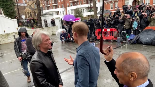 the duke of sussex and rock star jon bon jovi walked in the beatles' footsteps when they recreated the fab four's abbey road album cover includes... - footprint stock videos & royalty-free footage