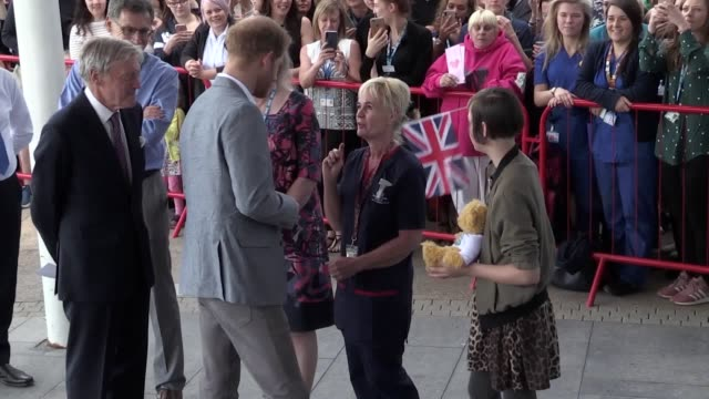 the duke of sussex arrives at oxford childen's hospital and talks to onlookers as part of a visit to the area. prince harry receives a teddy bear for... - oxford england stock videos & royalty-free footage