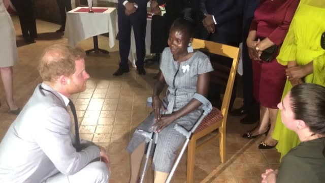 the duke of sussex meets landmine victim sandra tigica who princess diana met on her visit to angola 1997 during a reception at the british... - famiglia reale video stock e b–roll