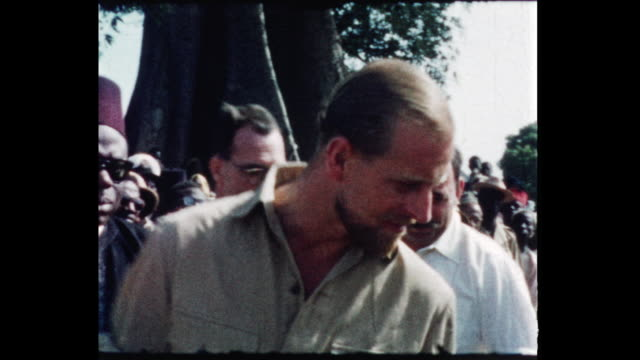 the duke passes amongst the machinery and other exhibits which are shown to him by the exhibitors the duke is hatless and is dressed in a khaki... - colonial stock videos & royalty-free footage