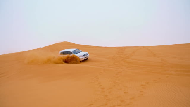 slo mo the dune bashing in dubai - arid climate stock videos and b-roll footage