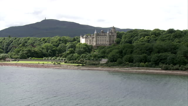 The Dunrobin Castle lies along the Sutherland shoreline in Scotland. Available in HD.