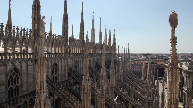 the duomo - the cathedral of milan, piazza del duomo, cathedral's roof-top north side, spires, flying buttresses, milan, italy - piazza del duomo milan stock videos and b-roll footage