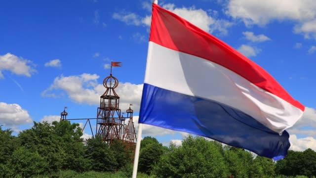 """the dutch flag waves in the wind near the steel replica of the """"uniastate"""" designed by artist bep mulder on july 12, 2020 in bears, the netherlands.... - illusion stock videos & royalty-free footage"""