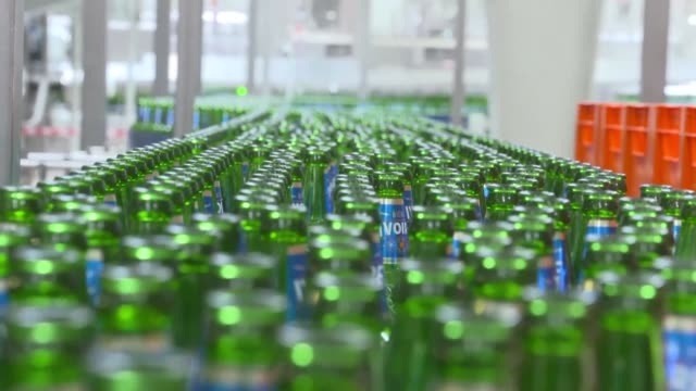 the dutch group heineken opens a new plant in abidjan breaking the over 50 year monopoly in the country's brewery industry held by the french wine... - côte d'ivoire stock videos & royalty-free footage
