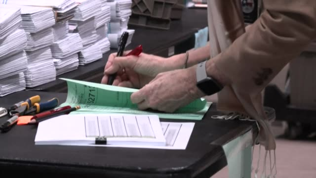 the early voting ballot board and signature verification committee workers are counting mailin ballots in houston on the eve of election day - verification stock videos & royalty-free footage